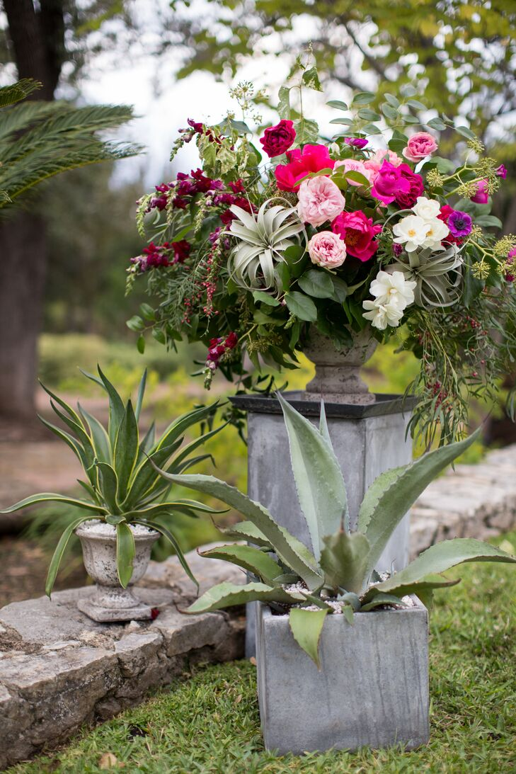 """""""We wanted to have a sort-of Southwestern palette for our flowers and wanted them to be fresh and bright but also soft,"""" Alicia says of their arrangements, which included cacti, succulents and an array of romantic blooms. """"Our wedding flowers were out of this world."""""""