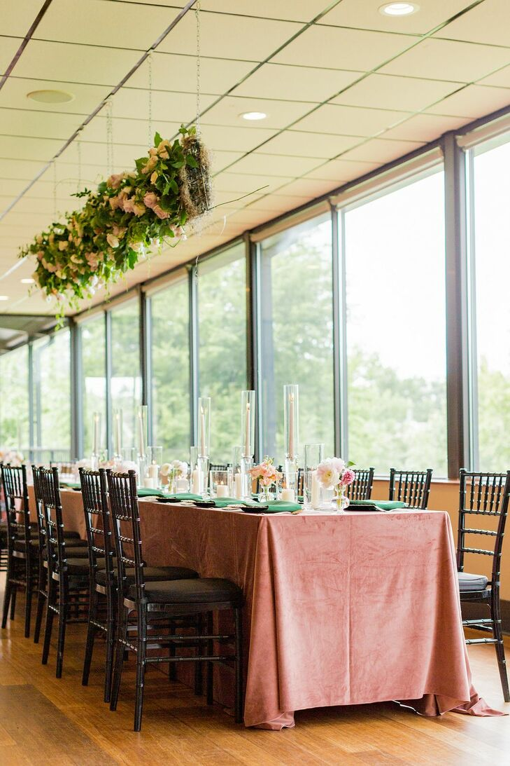 Reception Table With Pink Velvet Linens and Hanging Greenery Installation