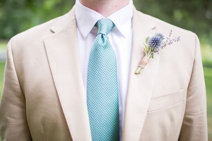 Liam accessorized his relaxed khaki suit with a teal tie and a rustic thistle boutonniere.