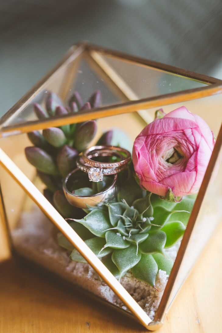 Dobi set Jill's grandmother's diamond in a classic white gold solitaire setting for her engagement ring, so Jill went modern for her wedding rings. She selected two rose gold stacking rings with mixed metal tones and prong-set diamonds, and Dobi chose a smooth palladium ring.