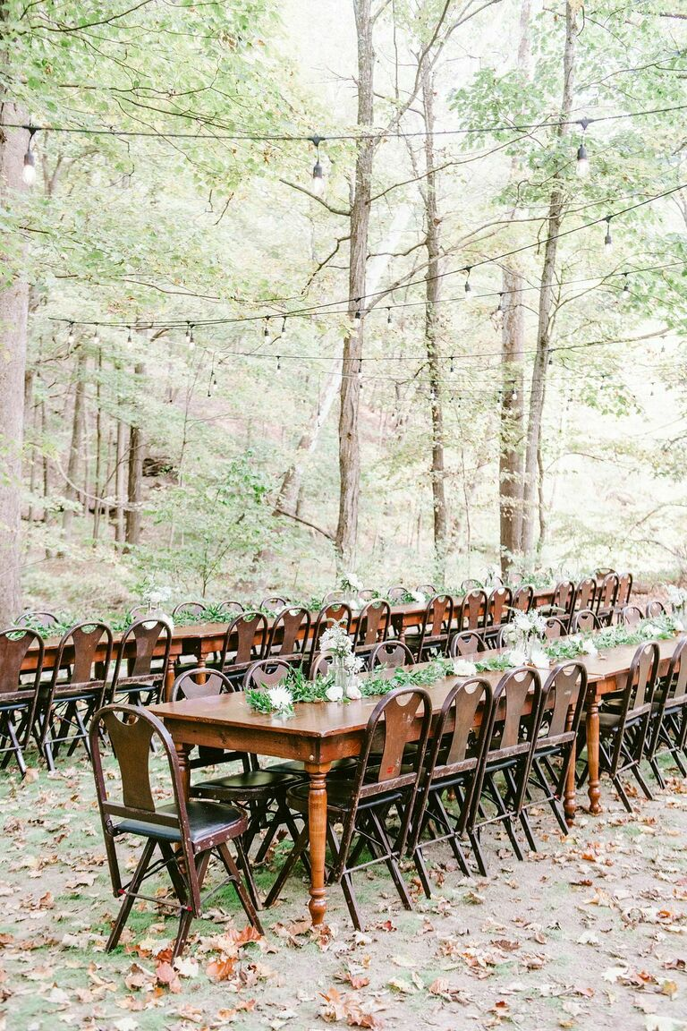 Long wood table with wood chairs situated in the woods