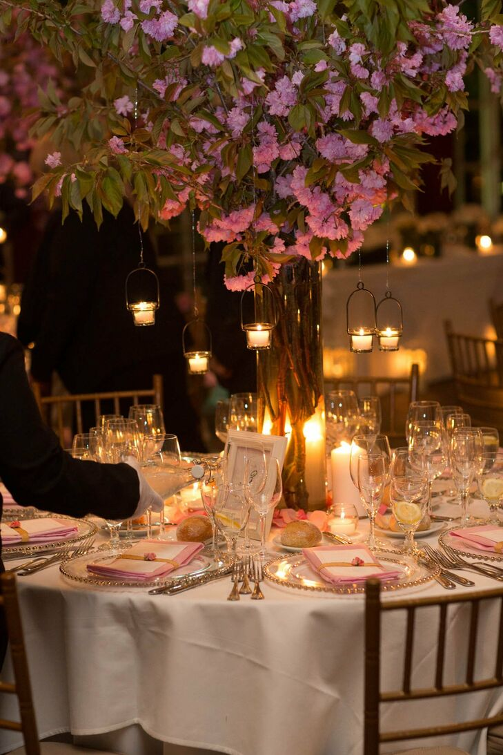 Some tables were topped with tall pink floral centerpieces with romantic hanging candles.
