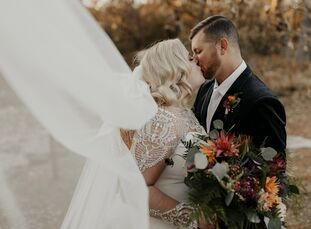 Ariel and Bryce's wedding at Prairiewood Retreat and Preserve in Manhattan, Kansas, was equal parts glam and moody. The couple's wedding included dram