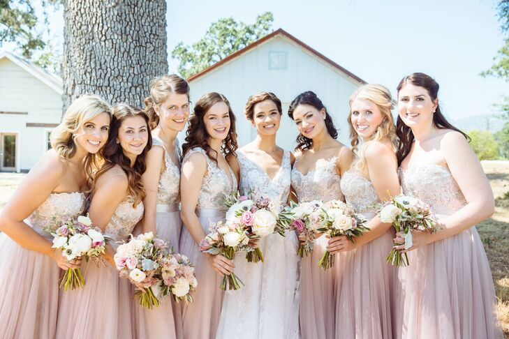 """""""For me, the bridesmaid dresses were just the beginning,"""" Claire says of finding inspiration for their big day in the form of each sequined lace, blush design. """"I incorporated the theme and color of the dresses into every detail, from the florals and linens to the escort card display and desserts."""""""