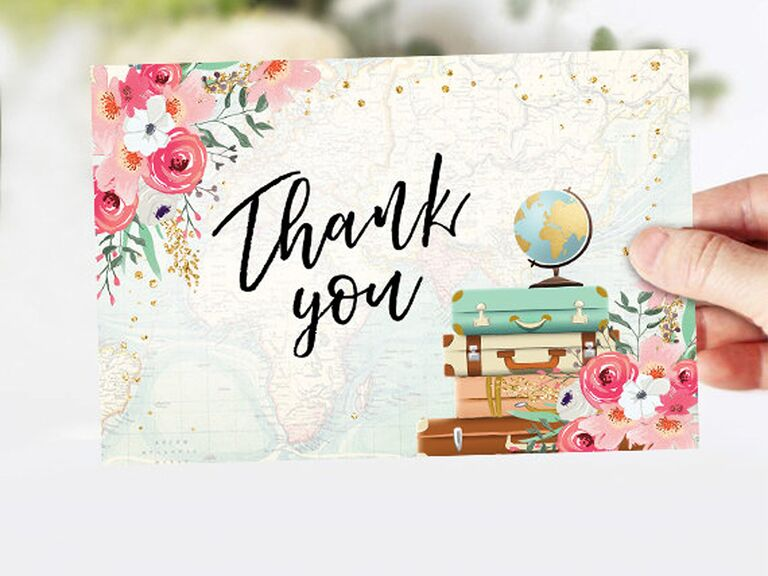 'Thank you' in black calligraphy with pink floral details and globe and luggage graphics on faded map background with gold flecks