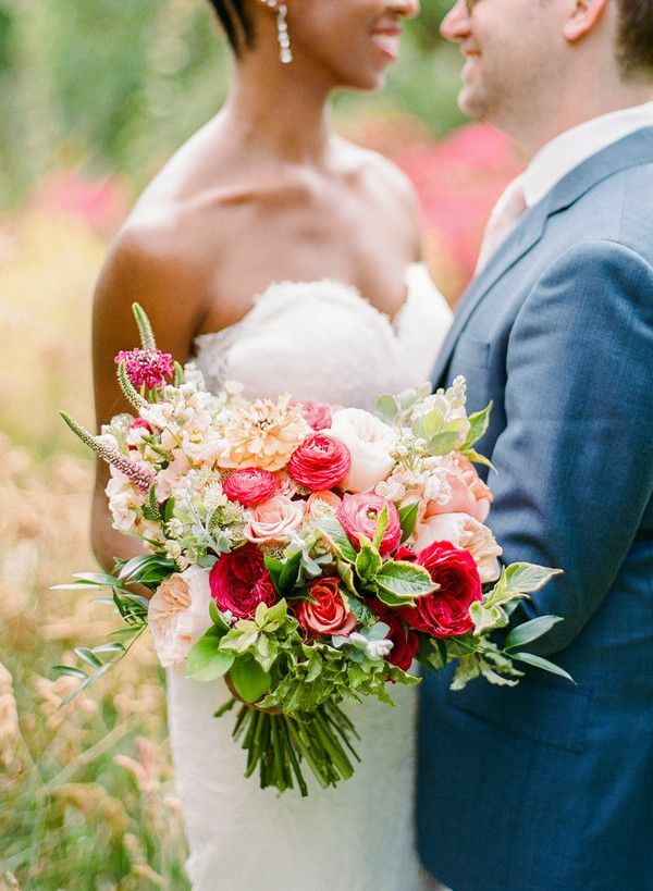Couple hugging and holding bouquet