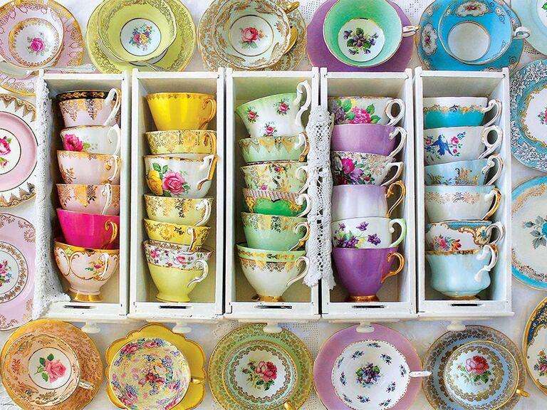 Colorful, mismatched vintage teacups with floral and gold details