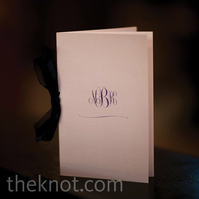 Simple white booklets adorned with a cursive monogram contained all of the ceremony details.