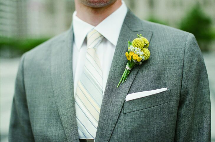 Yellow craspedia boutonnieres were pinned to the men's lapels.