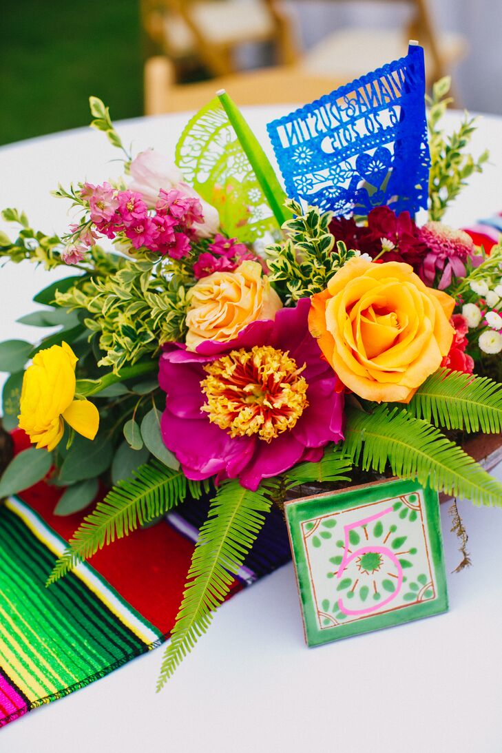 There was no shortage of color on the tables, from the Mexican blanket table runners to the gorgeous floral centerpieces and Mexican ceramic tiles used as table numbers.