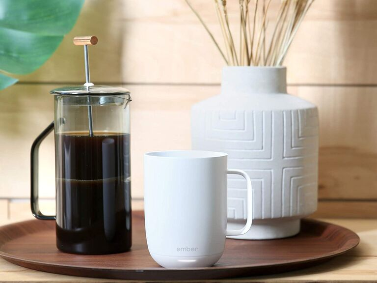 Ember smart temperature-control mug on tray with French press