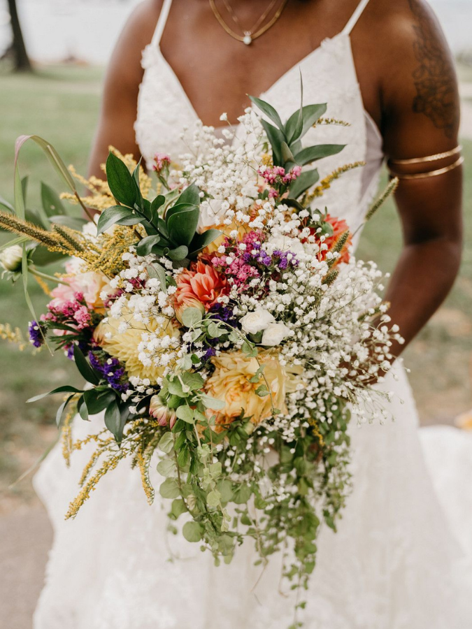 Bride holding wildflower bouquet with baby's breath