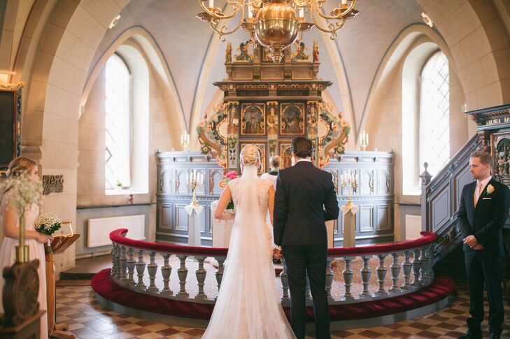 Ulrika and Victor decided to get married in a traditional Catholic church on the countryside of Sweden. They loved the adorable whitewashed venue and the ornate gold and wood detailing inside.