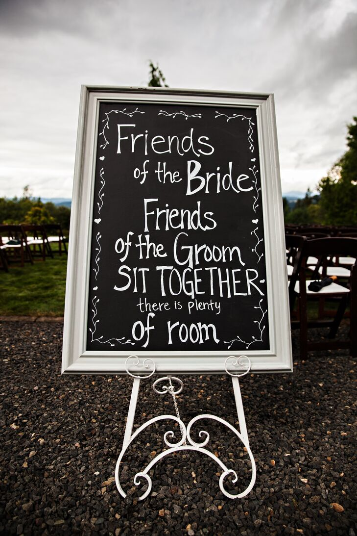 The bride penned all the signs scattered around the farm on the couples' big day--including this one at their ceremony.