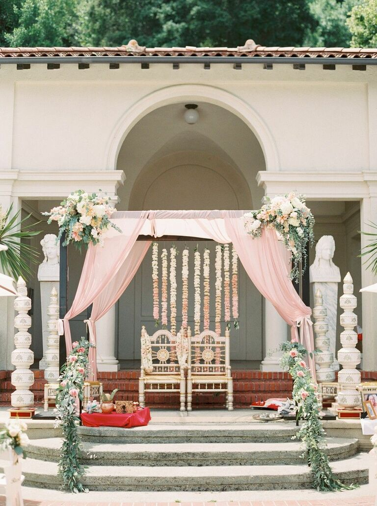 Romantic mandap with blush draping and greenery accents