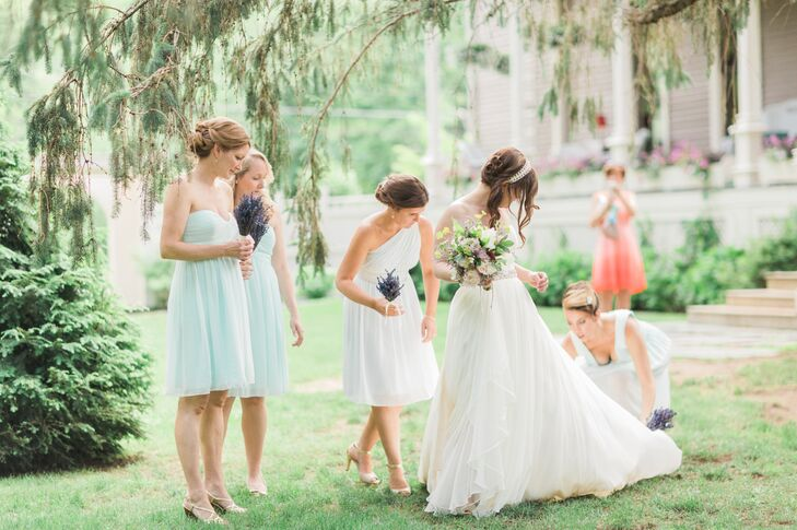 """Emily's bridesmaids wore knee-length Donna Morgan dresses in """"hint of mint"""" and """"beachglass."""" They styled their hair in updos for the day."""