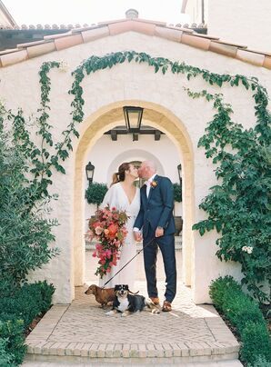 Bride and Groom Share a Kiss With Dogs