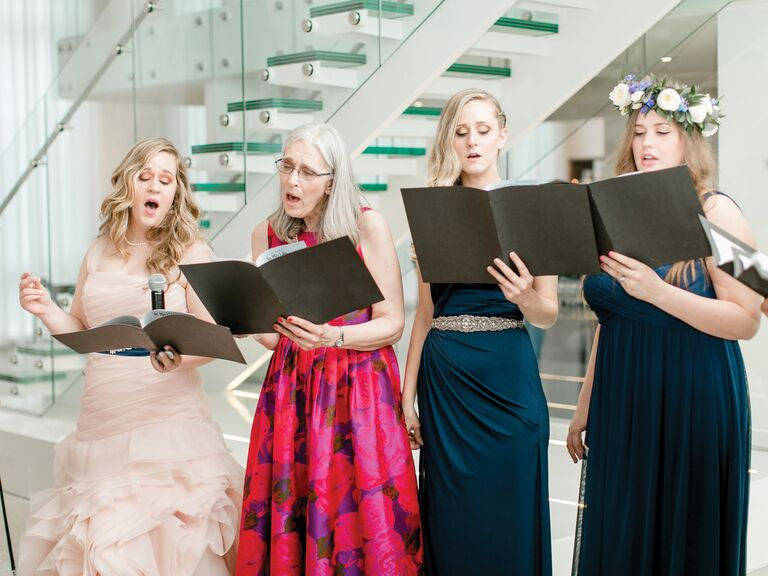 bride and bridesmaids singing during reception