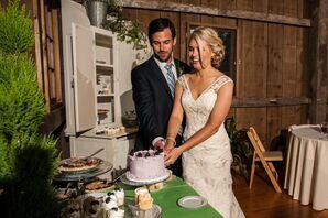 Bride and Groom Cut Blackberry Wedding Cake at Rustic Barn Wedding