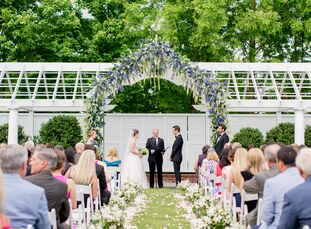 Drawing inspiration from their venue's waterfront locale, Kristin Darwin and Paul Gessler filled their chic spring celebration with modern watercolor