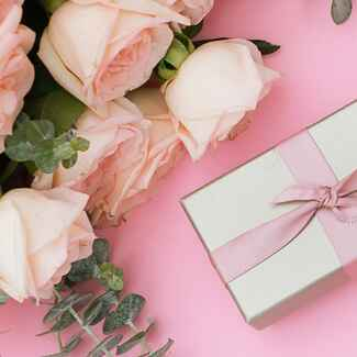 wrapped gift on table with flowers