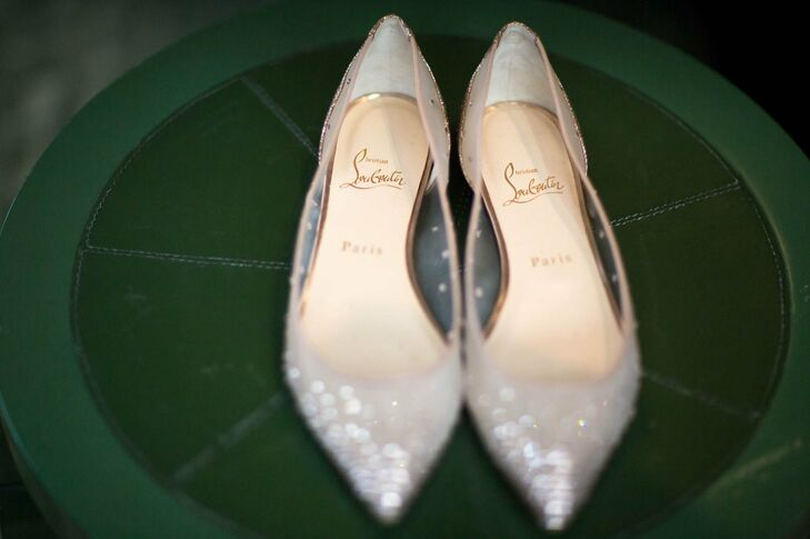 The bride sparkled from head to toe thanks to metallic, pointed-toe Louboutin flats.
