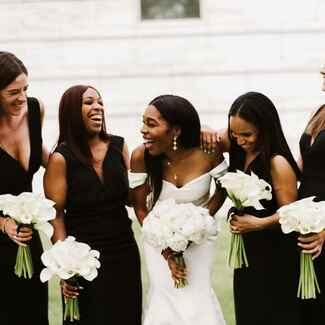Bride with bridesmaid at wedding