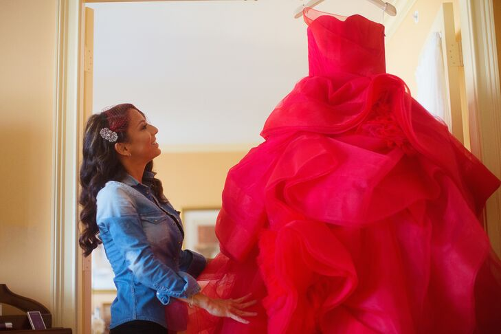 """'My wedding dress was red and entirely unplanned. Once purchased, I decided to make it a surprise for the guests and the groom,"""" says Amina. """"It was a unique choice and quite untraditional, that pretty much sums me up in a nutshell - a nonconformist."""""""