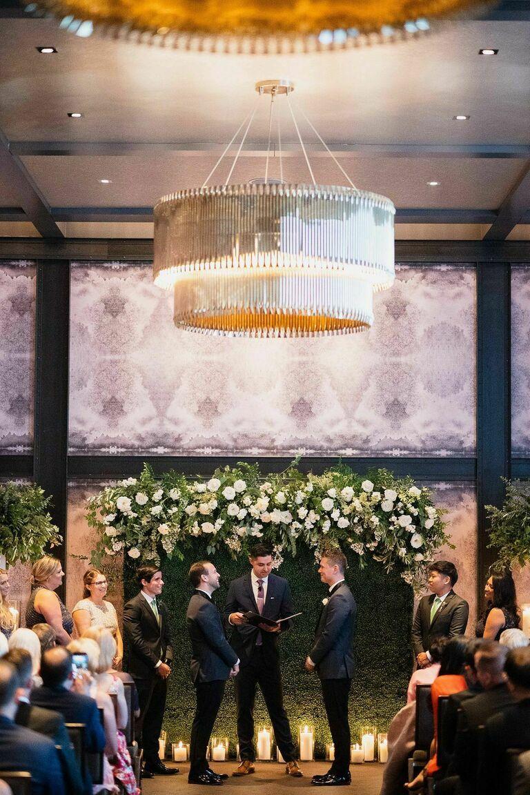 Ballroom wedding ceremony with silver chandelier
