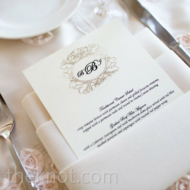 Justine actually made the menu cards. She designed them with the couple's monogram surrounded by an ornate scroll design.