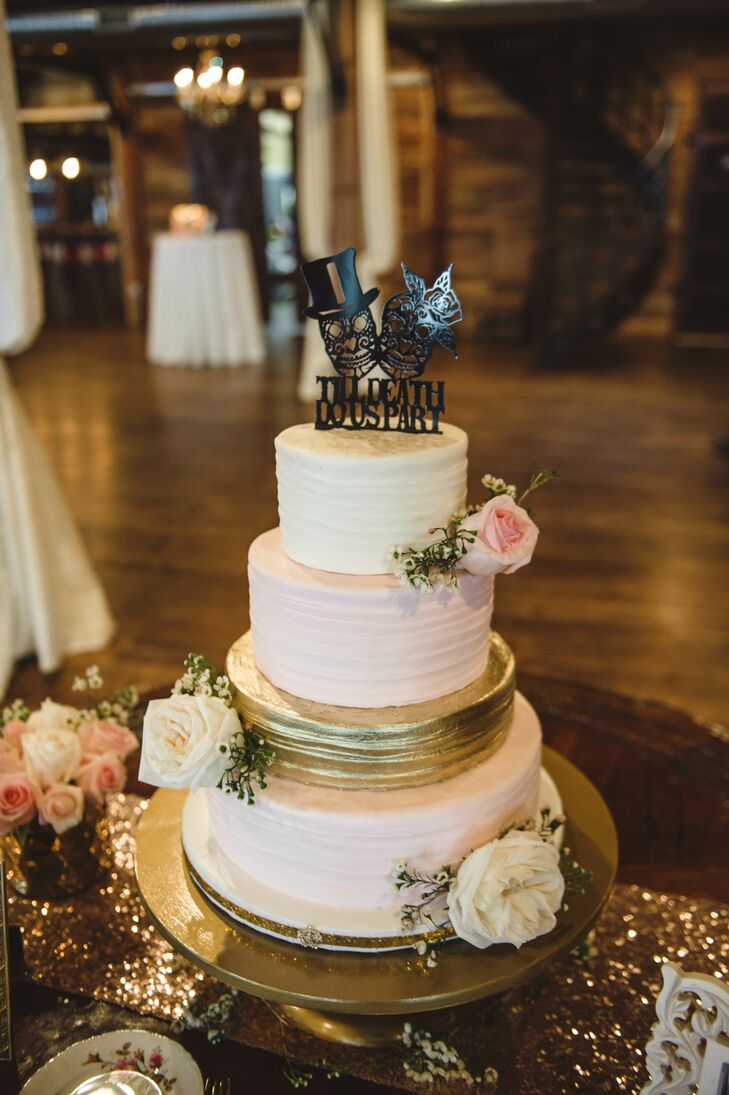 Laura and Levi's cake from Madison's on Main embodied the garden glam theme. It had a metallic gold tier in the center of blush and ivory tiers accented by garden roses, and a whimsical skull cake topper in black.