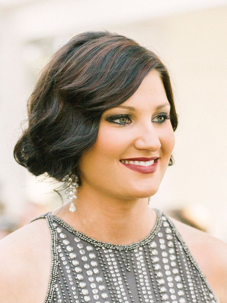 vintage wedding hairstyle low bun with s-shape curl