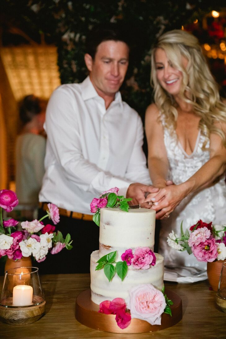 Cutting Semi-Naked Cake with Pink Flowers and Gold Stand