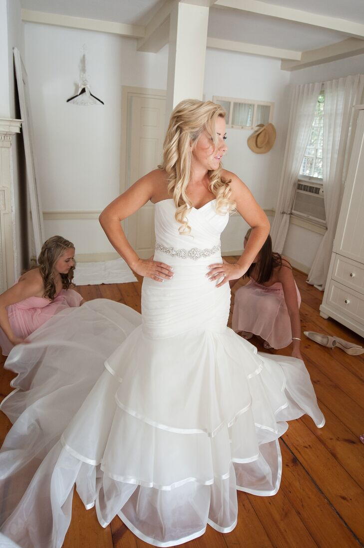 """Kristine wore a strapless ivory wedding dress that flared at the bottom. """"I did add a belt to add some sparkle!"""" she says."""