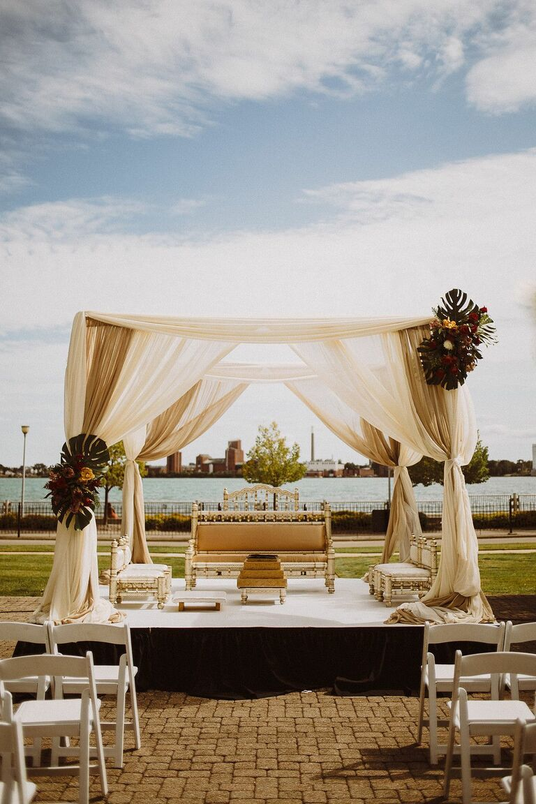 Beige mandap with Monstera leaf accents