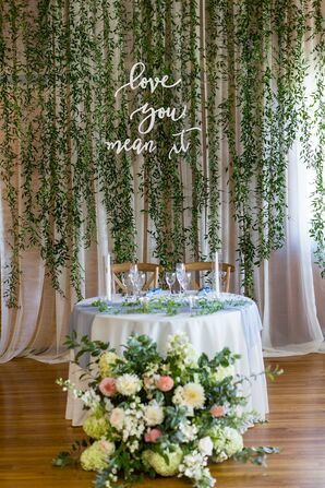 Classic Sweetheart Table with Hanging Greenery and Flower Arrangement