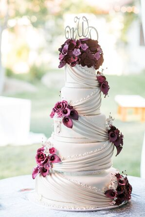 Classic Ivory Cake with Draping and Dramatic Purple Flowers