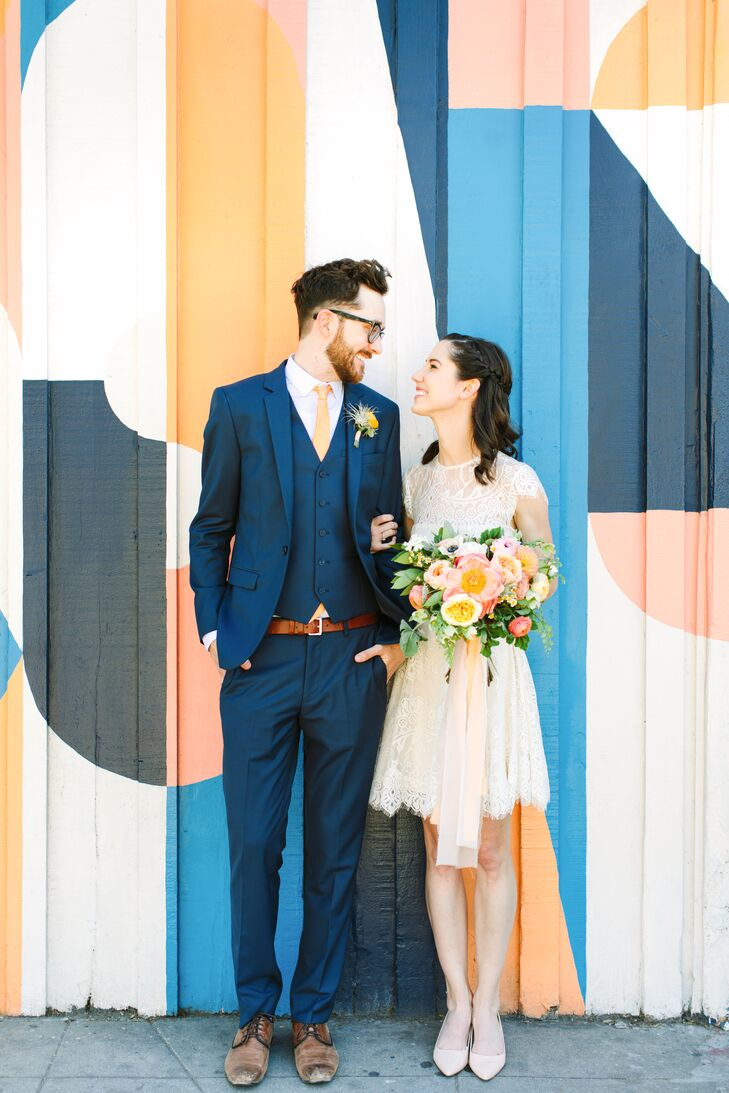 Modern Groom in Navy Blue Suit and Bride in Short Lace Dress