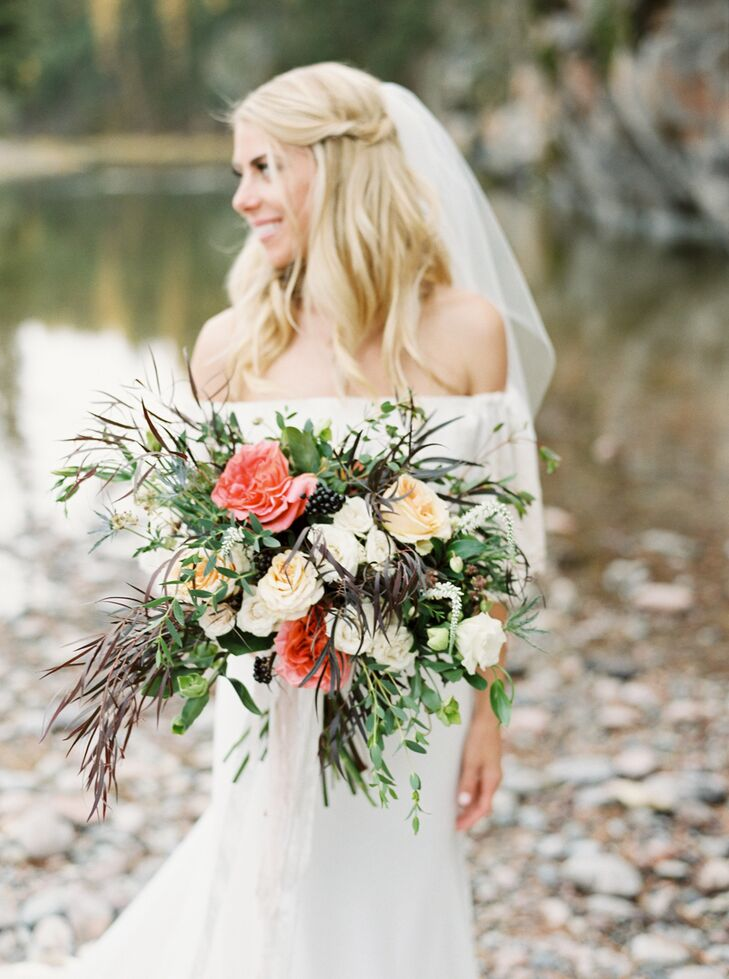 """""""My bouquet had a whimsical look with blush and ivory roses and lisianthus, accented with burgundy foliage, local Montana wildflowers, and sage greens,"""" says Sarah, who relied on Habitat Floral Studio for all her blooms."""