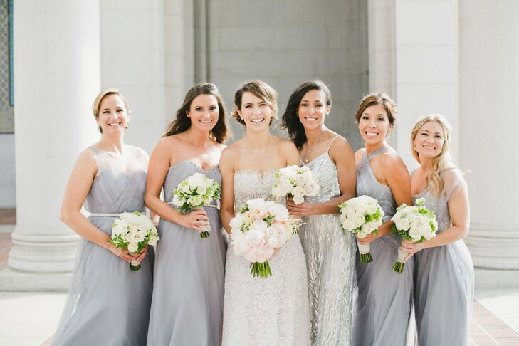 Shannon tried on more than 300 dresses before deciding on a strapless Mira Zwillinger gown. Her bridesmaids wore a variety of full-length gray dresses by Bella Bridemaids with different fits and necklines.