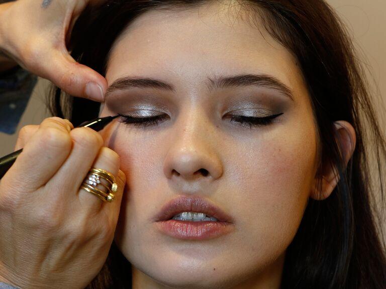 Pati Dubroff applying makeup to a Pronovias model