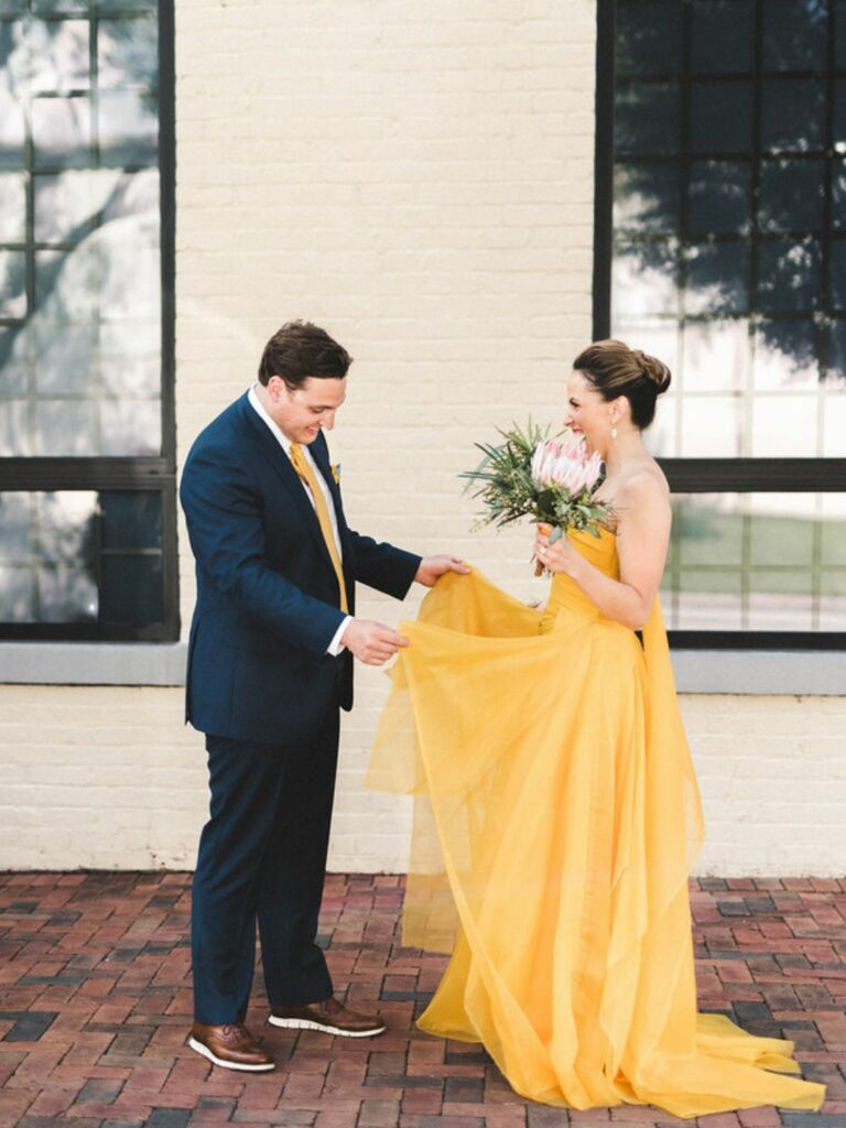 First look with bride in yellow