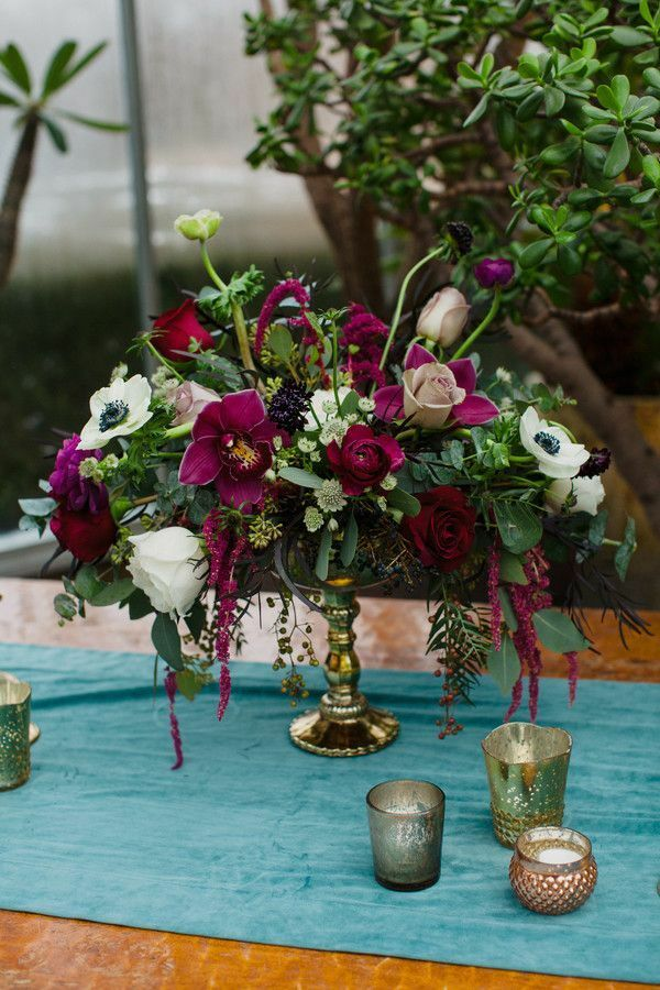 Centerpiece with amaranths, orchids and anemone blooms