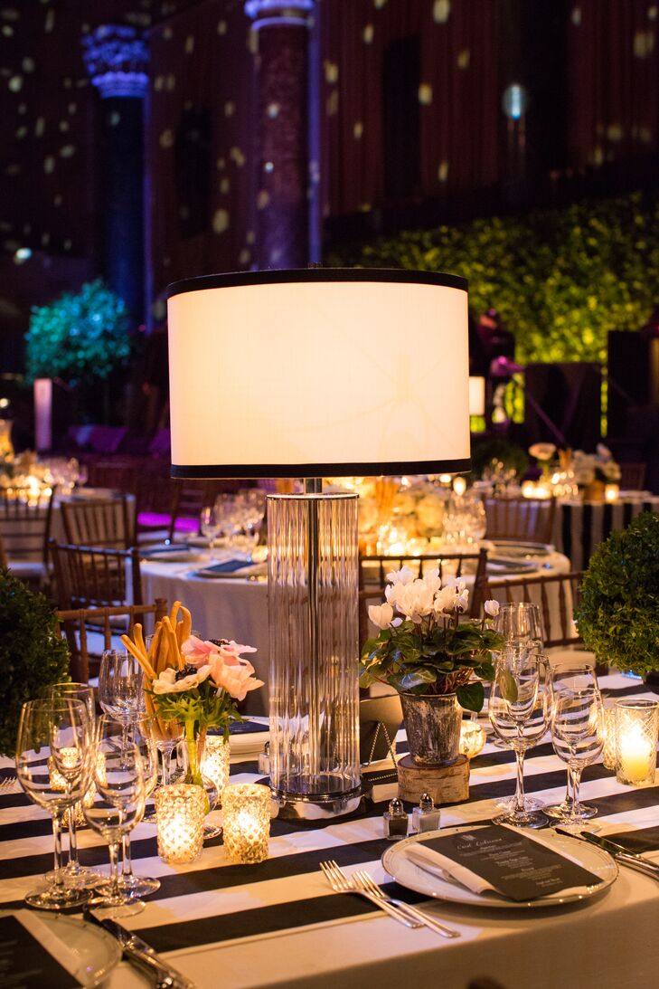 """Several tables at the reception were topped with small floral arrangements, votive candles and glass table lamps, which made the space look """"unique and more like an intimate dinner party meets supper club."""""""