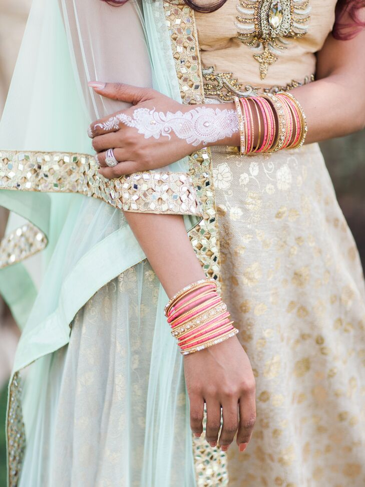 """""""I was decorated head to toe in the most gorgeous traditional Indian jewelry,"""" says Arselie. """"Earrings, bangles, jewels on my fingers, jewels over my eyebrows, and three necklaces—and I loved my headpiece so much I wore it the entire night!"""""""