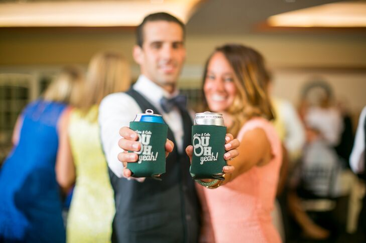 """Our favors were drink cozies that were the colors of our Alma Mater (green and white,) says the couple. """"They were designed by the bride's brother and included a common saying from OU alumni """"OU OH yah"""" with the two O's being the bride and groom's rings."""""""