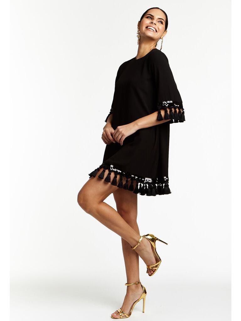 Black mini dress with tassel sleeves and hemline