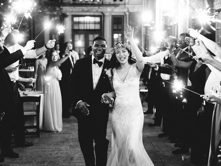 Bride and groom exiting wedding reception with sparklers