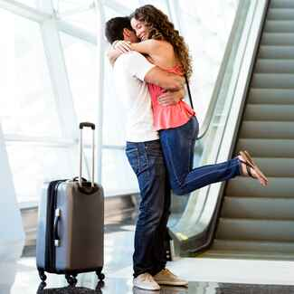 couple hugging airport long distance relationship