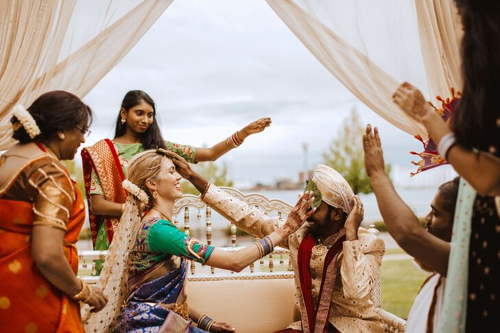 Couple Placing Hands on Each Other During Hindu Wedding Ceremony